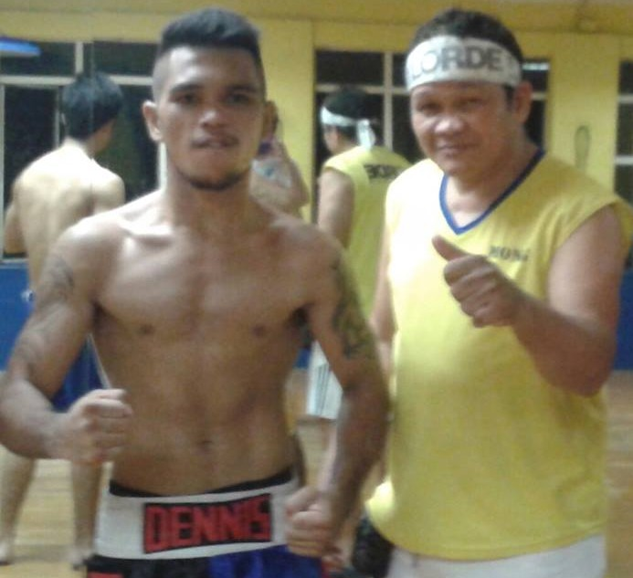 Dennis Tubieron with his trainer Jose Homber Mana-ay at the Elorde Boxing Gym in Manila, Philippines.