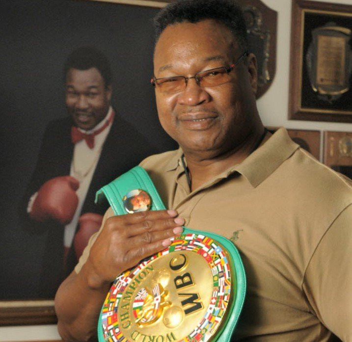 larry-holmes-with-championship-belt